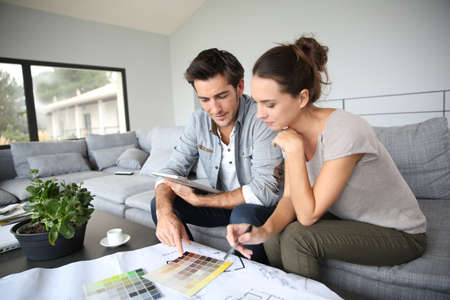happy wife: Couple searching ideas to decorate new home