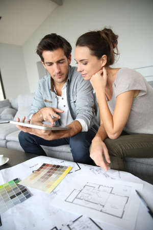 interiors: Couple searching ideas to decorate new home