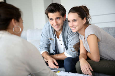 financial plan: Couple meeting architect for house construction