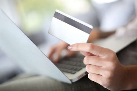 secured payment: Hand holding credit card to buy online