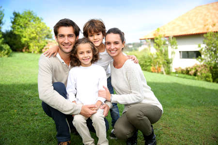 happy family house: Cute family portrait of 4 people Stock Photo