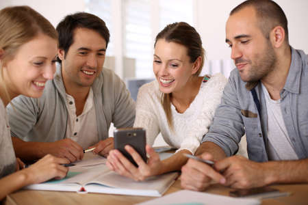 Group of business people in office using smartphone photo