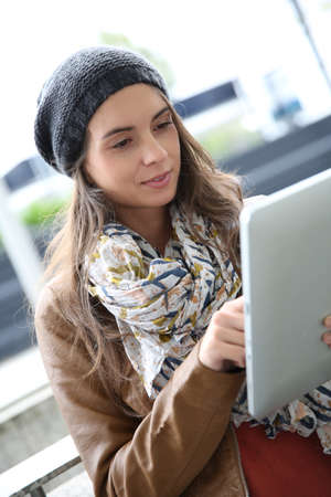 websurfing: Student girl websurfing on internet with tablet Stock Photo