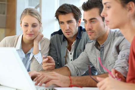 working on school project: Group of young people working together in office Stock Photo