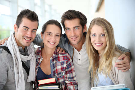 four friends: Portrait of cheerful friends at university