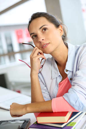 officeworker: Student girl with thoughtful look Stock Photo