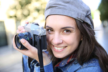 trendy girl: Portrait of trendy girl holding camera