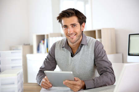 Portrait of architect using tablet in office photo