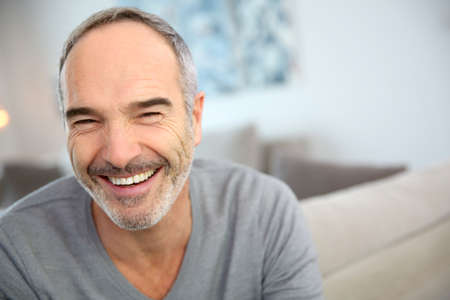 Portrait of happy handsome mature man Stock Photo