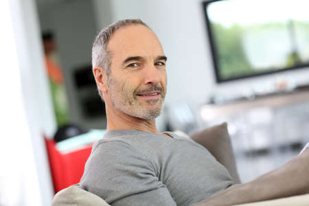 guy person: Senior man relaxing in sofa at home Stock Photo