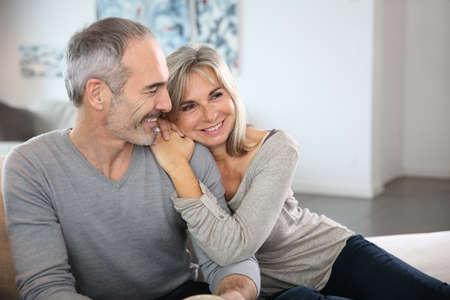 Romantic senior couple relaxing in couch  Reklamní fotografie