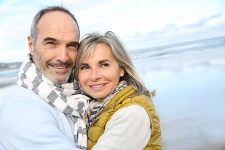 winter wedding: Portrait of loving senior couple at the beach Stock Photo