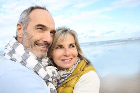 Portrait of loving senior couple at the beach Stock Photo