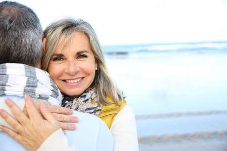 senior man: Portrait of loving senior couple at the beach Stock Photo