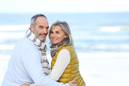 Senior couple sitting by the beach  Stock Photo - 23998949