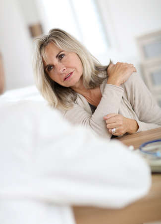 medicalcare: Patient seing doctor for shoulder articulation pain