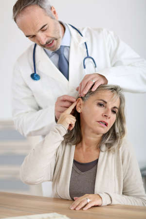 senior man on a neck pain: Senior woman feeling neck pain
