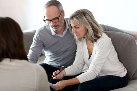 financial planning married: Senior couple meeting financial adviser for investment Stock Photo