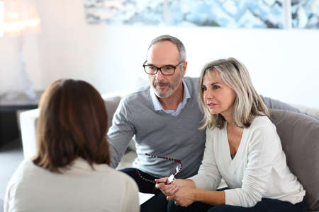 financial insurance: Senior couple meeting financial adviser for investment Stock Photo