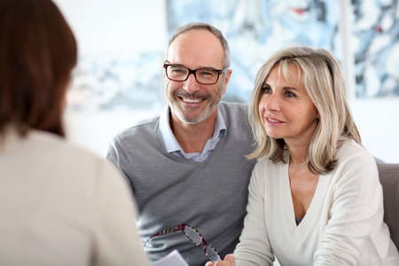 a marriage meeting: Senior couple meeting financial adviser for investment Stock Photo