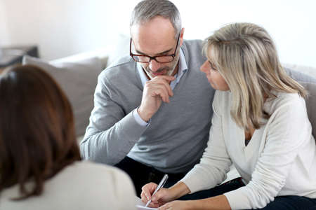 insurance consultant: Senior couple meeting financial adviser for investment Stock Photo
