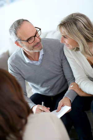 50 years old man: Senior couple meeting financial adviser for investment Stock Photo