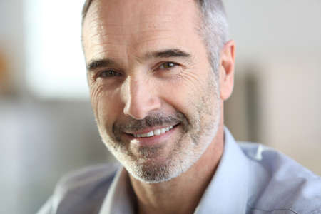 old man smiling: Closeup of handsome senior man with grey hair