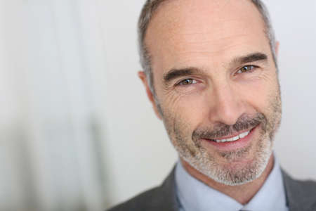 unshaved: Confident 50-year-old businessman