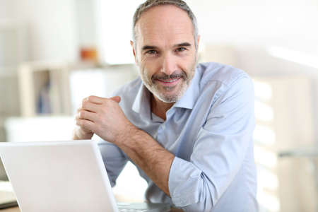 old man: Senior businessman working on laptop computer Stock Photo