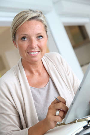 working from home: Businesswoman working from home with tablet