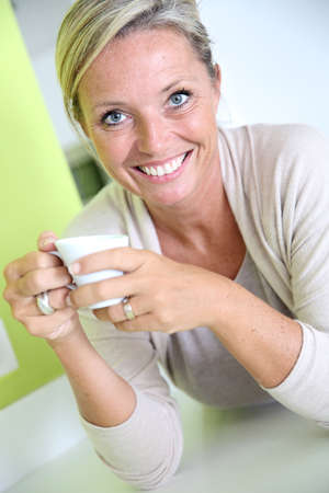 Beautiful attractive woman drinking coffee  photo