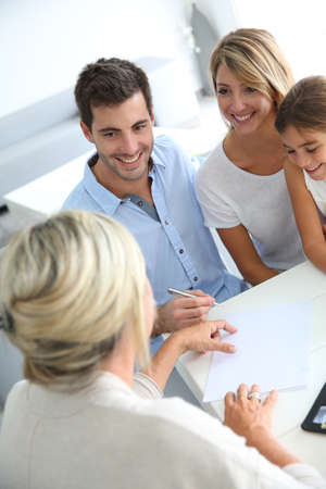 bankers: Family meeting real-estate agent for house investment