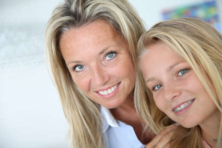 Portrait of mother with teenaged daughter photo