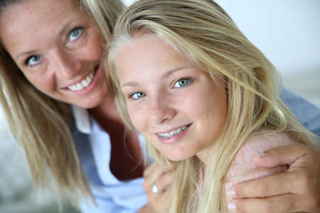 teenaged: Portrait of mother with teenaged daughter