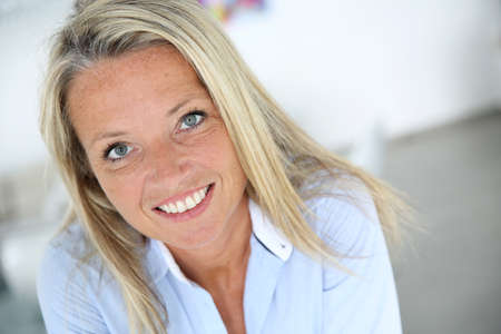 blonde blond: Portrait of smiling 40 year old woman Stock Photo