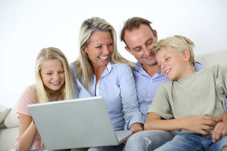 skype: Family connected on internet with laptop  Stock Photo