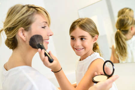 beautycare: Little girl playing with her moms makeup