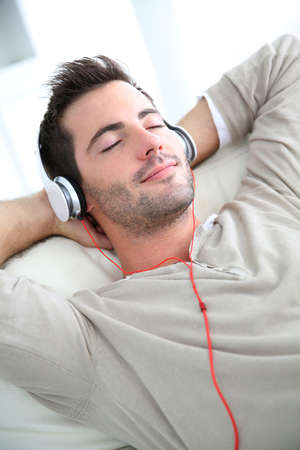 young man: Young man listening to music with headphones Stock Photo