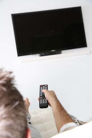 flatscreen: Closeup of remote control and tv set