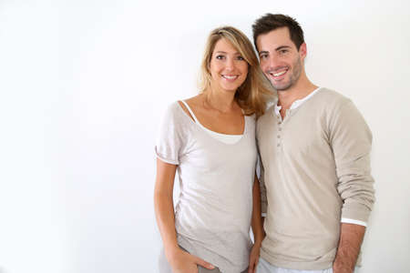 Cheerful couple standing on white