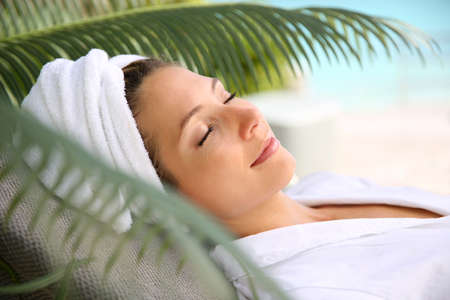 beauty center: Woman relaxing outside spa resort Stock Photo