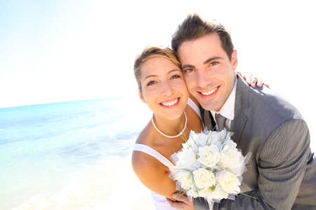 just married: Portrait of just married couple by the beach