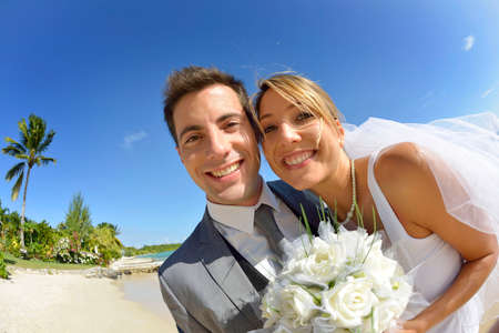 getting married: Cheerful couple getting married on the beach