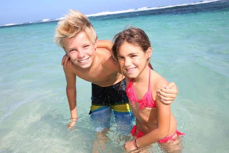 Kids having fun at the beach Stock Photo