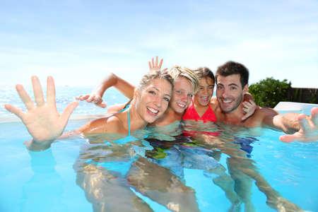 infinity pool: Happy family enjoying bath time in infinity pool