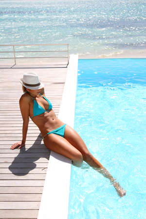 seaview: Beautiful woman relaxing by the pool