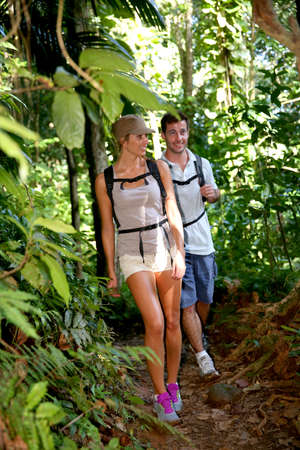 adventurers: Couple on a trekking day in tropical forest