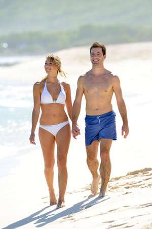 guadeloupe: Young couple walking on paradisiacal beach