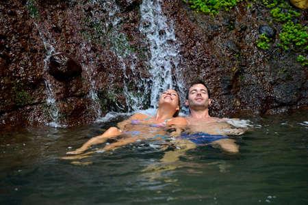 adventurers: Couple enjoying bath under waterfalls