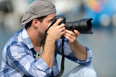 globetrotter: Photographer shooting outdoors scenery Stock Photo